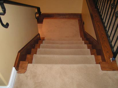 Fixing up a staircase-carpeted-stairs-wood3.jpg
