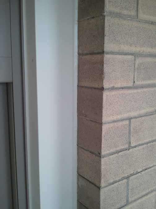best window sealant-caulk-brick.jpg