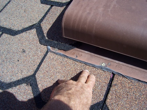 ice and water shield-caulked-vent-splitting-shingles.jpg