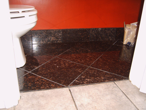 Tile vs Wood as a baseboard-chestnutgranite_bath.jpg