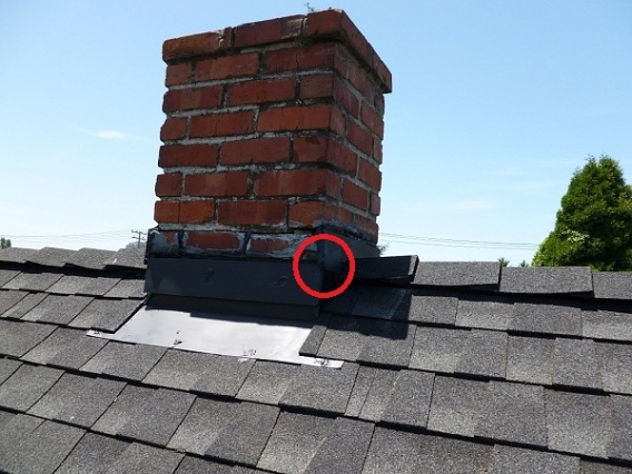 Is this chimney flashed properly?-chimney.jpg