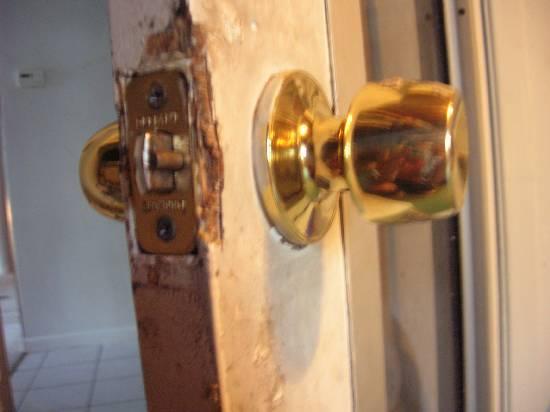 repairing damaged wood on older doors, frames, etc (peeling, chipped, etc)-chunks-missing-latch-plate.jpg