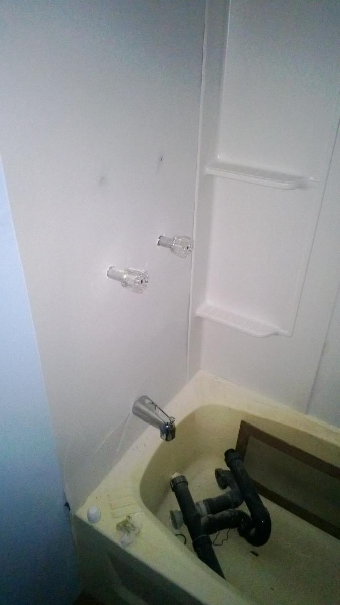 Complete Mobile Home Remodel-closeup-shower-hardware.jpg
