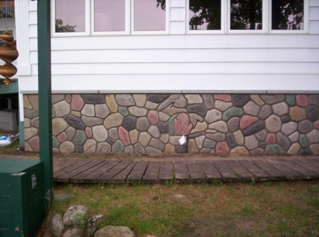 "Should I ""parge"" a concrete foundation wall exterior?-cobble-wall.jpg"
