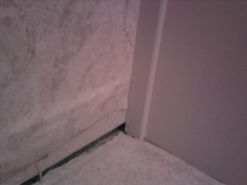 Install baseboard over/around existing trim of bathroom vanity?-corner.jpg