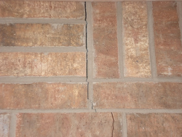 Potential foundation issues-crack-near-top-house.jpg