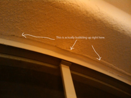 Drywall around arched window falling apart-crack2.jpg