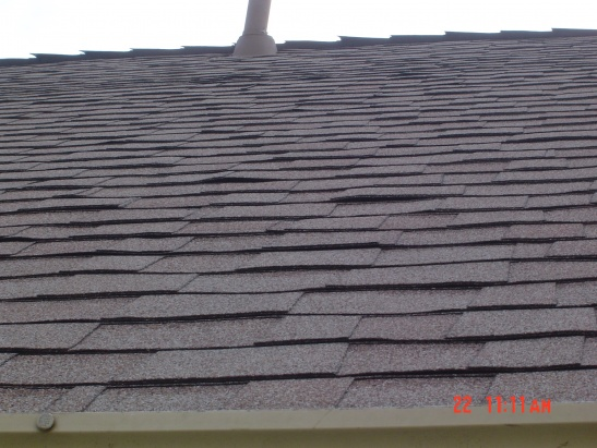 New roof install shingles are cupped.-cupped-shingles-roof-view.jpg