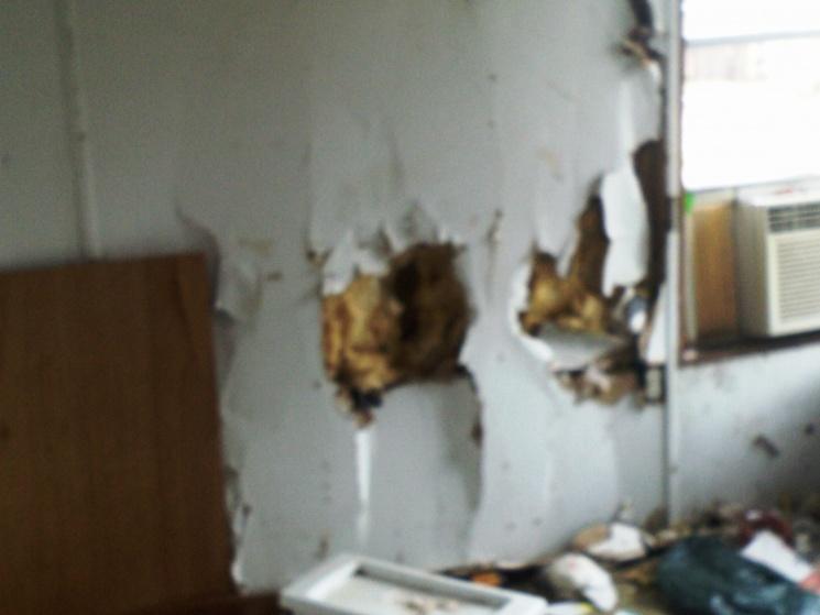 Complete Mobile Home Remodel-damage-master-bed.jpg