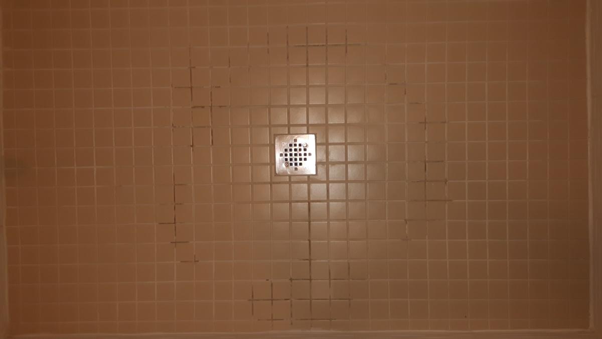 Shower Floor Tile Grout Water Damage In Pattern Around Drain Water