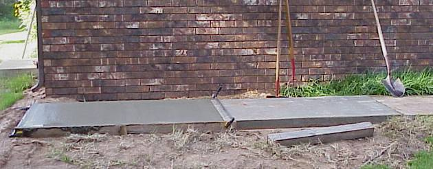 Pouring a concrete slab-deck-sidewalk-second-pour-7-19-07.jpg