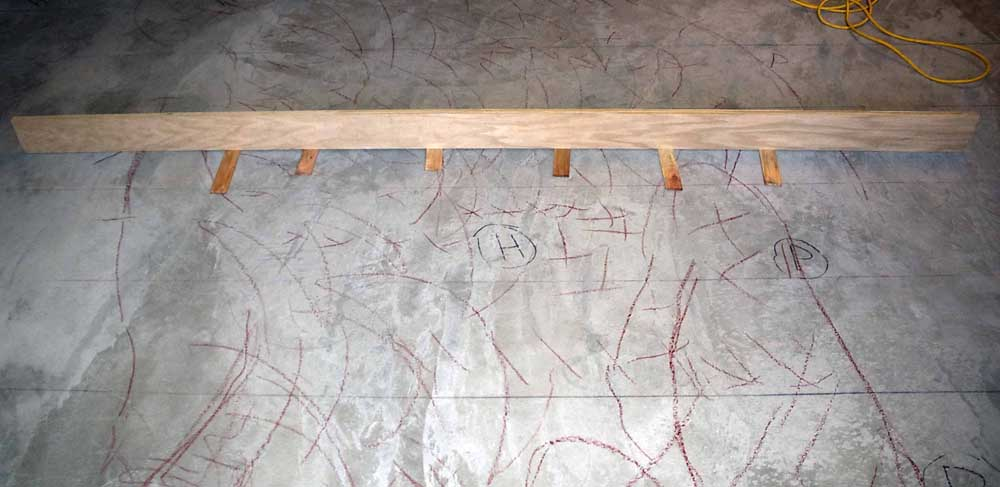 How to repair a concrete floor we just had repaired!-depression-marked-red.jpg
