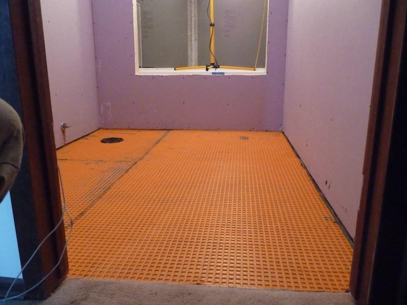 Off work for the next week completely remodeling bathroom-ditra-floor.jpg