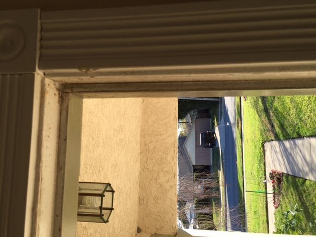 Sealing air gap around front door-door2.jpg