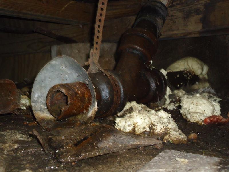 Replacing Broken Cast Iron Pipe In Crawl Space Plumbing