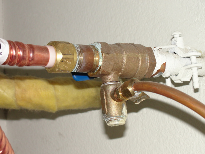 Water heater leaking at cold water inlet outside.-dsc06383.jpg