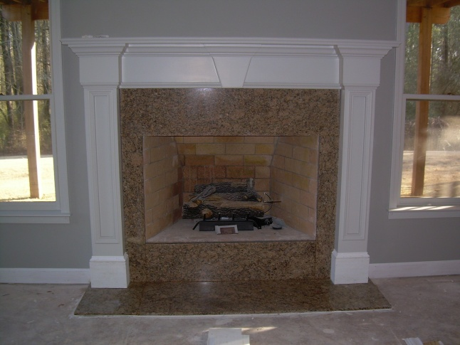 Lay sheetrock over fireplace with wood burning insert for Wood burning fireplace construction