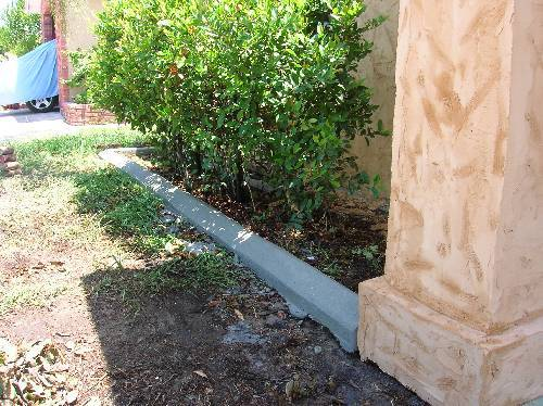 mortar poured landscape edgers-edgers-front-bush.jpg