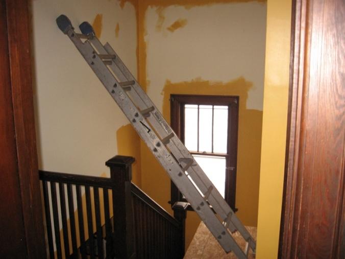 Working in Stairwells-extension-ladder-over-rail.jpg