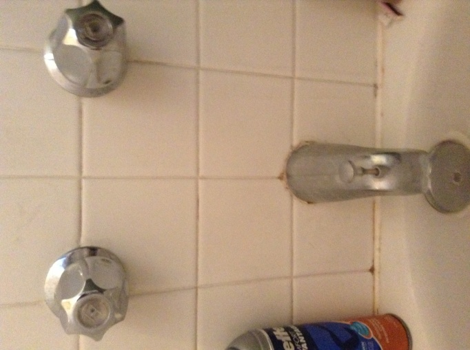 Shower handles turned off but water still dripping-faucet.jpg