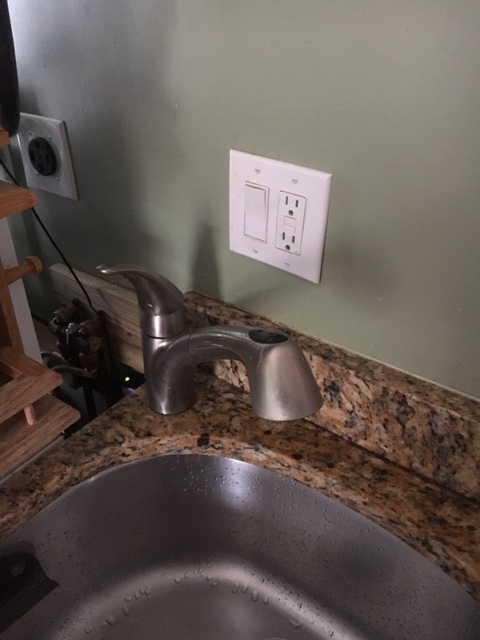 New water heater only sending hot water for a short while-faucet.kitchen.jpg