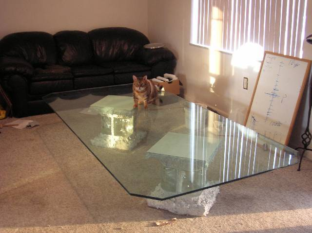 Custom built legs for very large glass tabletop-finished-table.jpg