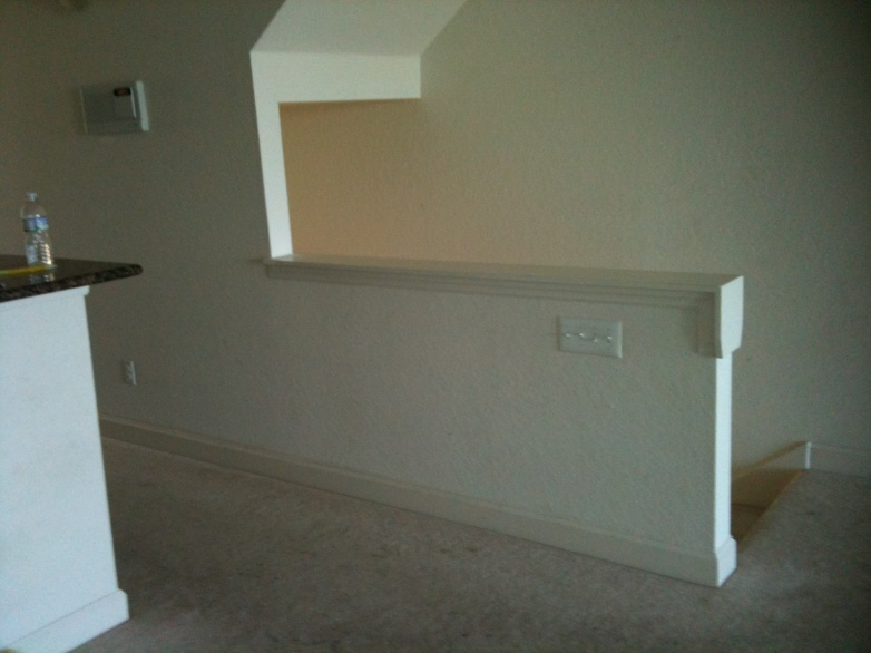 Remove half walls & replace with wood railing/balusters-first-floor_70in-wall.jpg