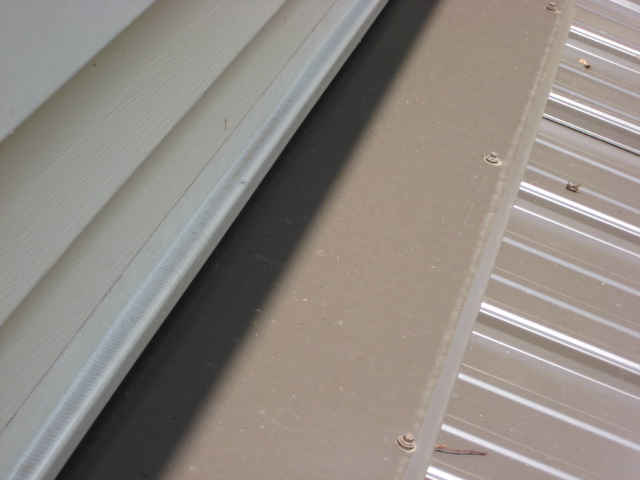 Vinyl Siding Above Pitched Porch Roof - How To Secure The