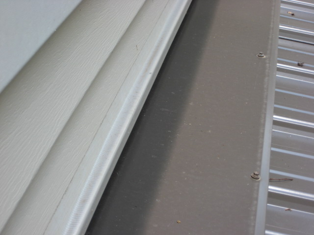 Vinyl Siding Above Pitched Porch Roof How To Secure The