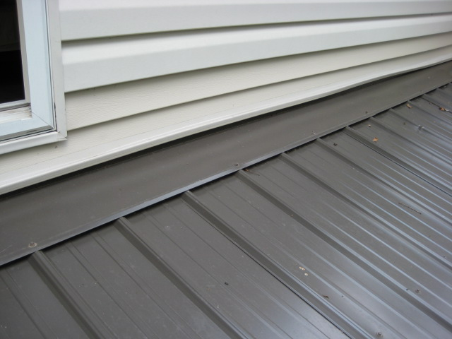 Vinyl siding above pitched porch roof - how to secure the bottom of the siding?-flashing-after-006.jpg