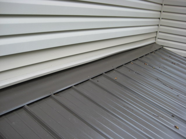 Vinyl siding above pitched porch roof - how to secure the bottom of the siding?-flashing-after-007.jpg
