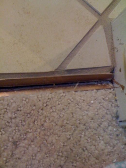 tile/carpet threshold bad job can it be fixed?-floor-2.jpg