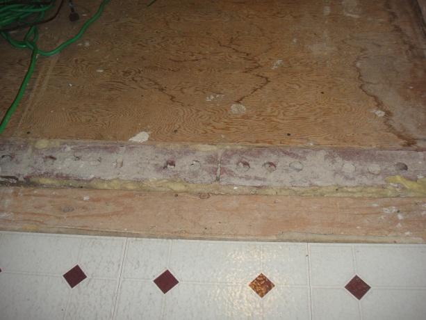 Leveling a floor across original exterior wall-floor.jpg