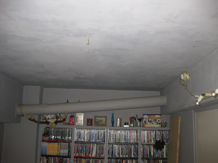 My neighbor upstair hears all sound from my apartment-front-room-cement-ceiling.jpg