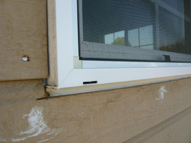 Exterior window trim.  Prevent water leak.-front-window-trim-3-.jpg