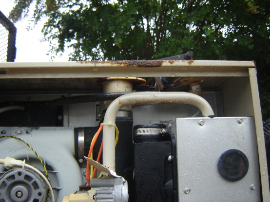 How does hole in Gas Furnace cabinet contribute to carbon monoxide in crawl space.-furnace-003.jpg