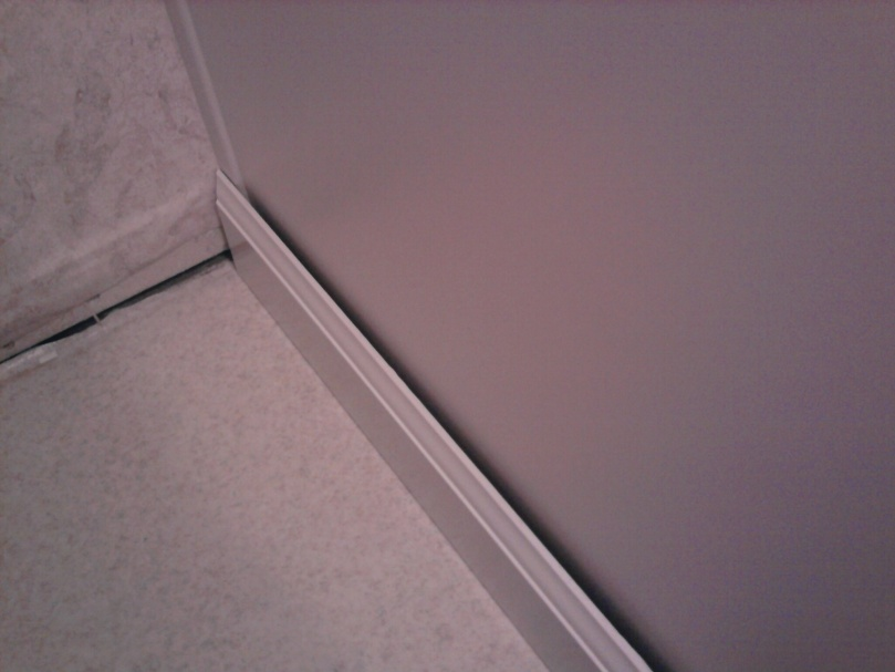 Install baseboard over/around existing trim of bathroom vanity?-gap.jpg