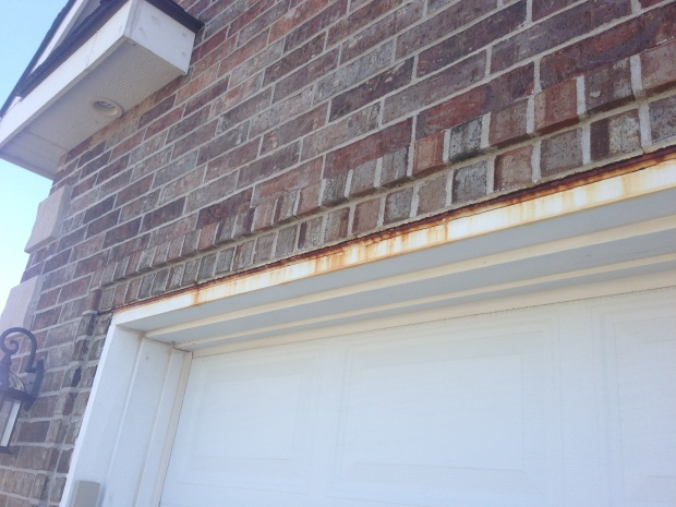 Rust on exterior trim above garage-garage-door.jpg