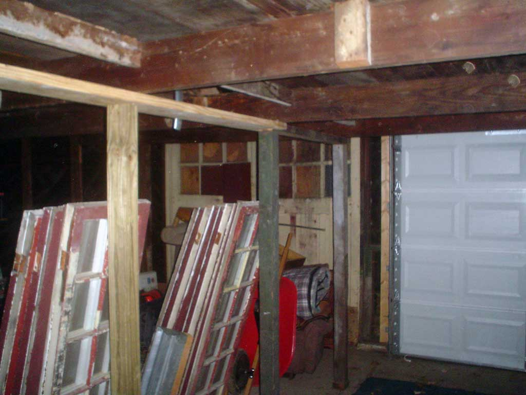 Raising overhead joists in my garage.  Is this a good idea?-garage2.jpg