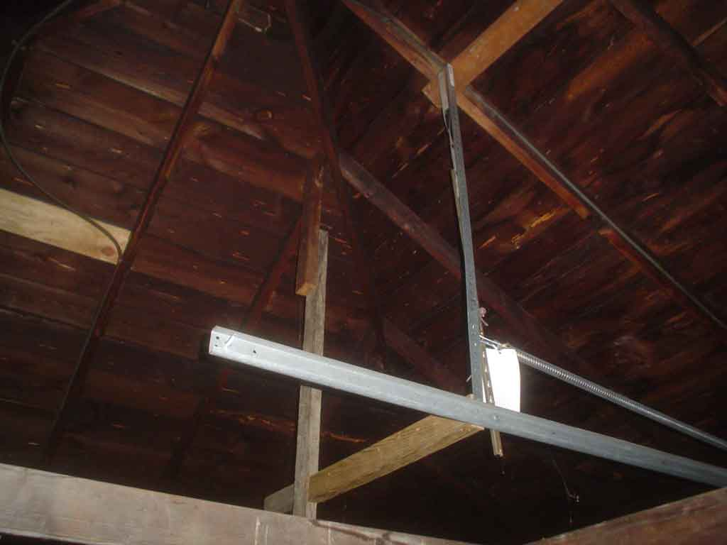 Raising overhead joists in my garage.  Is this a good idea?-garage_door_track2.jpg