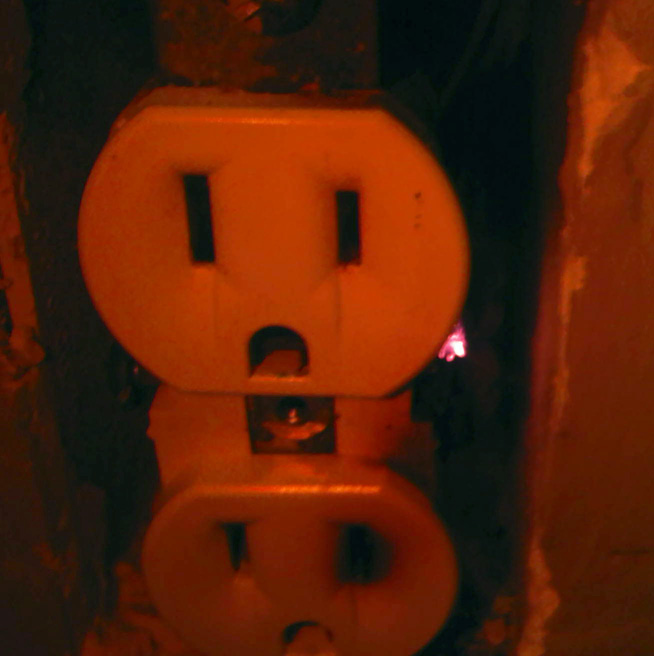 Vacant receptacle is hot to touch-glowing.jpg