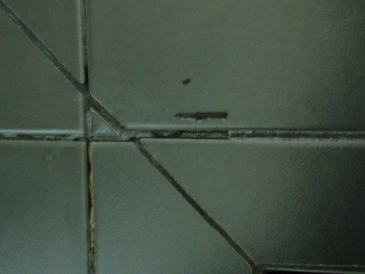 Grout peeling out from shower floor tiles. What's the problem?-grout-peeling1.jpg
