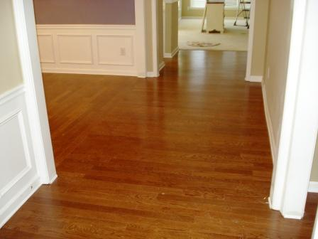 Wood Laminate Hallway Transition At Junction Flooring
