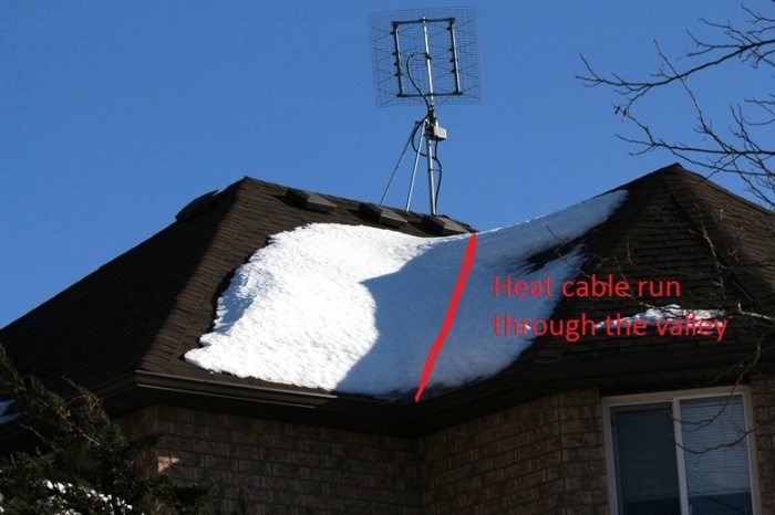 Leaking 3 years old shingle roof-heat-cables.jpg