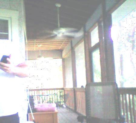 Have a tin roof & squirrels are getting on porch-house-3.jpg