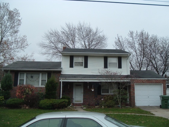 Laying new roof after removal of old roof-house-front.jpg