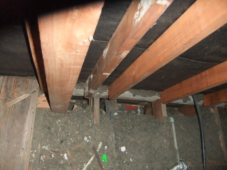 adding attic insulation - cope with brick wall-house-gap-outer-wall-sm.jpg
