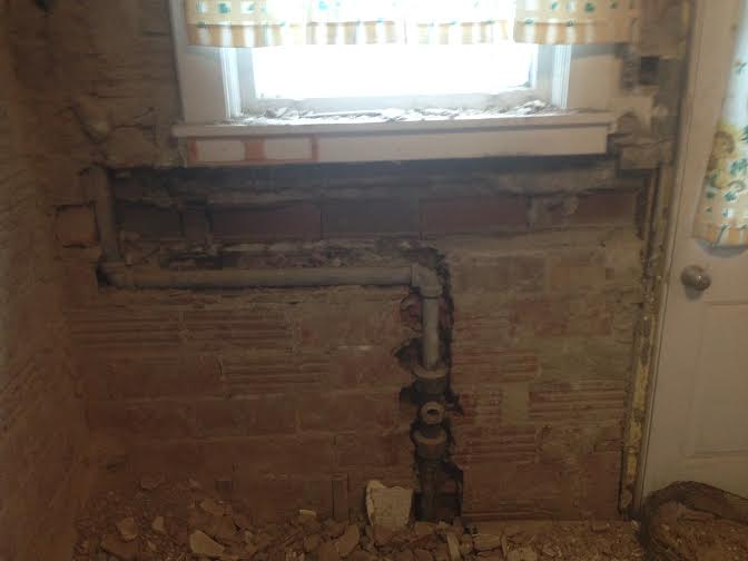 Ideas on how to repair the brick that was broken for the pipes-house-photo.jpg