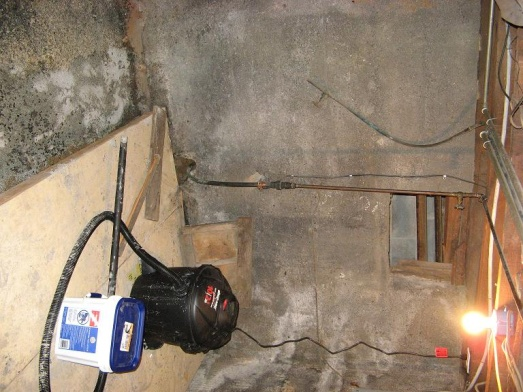 water pouring into basement from around water supply line-house4.jpg