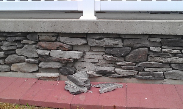 Decorative stacked stone falling off porch foundation-imag1308.jpg